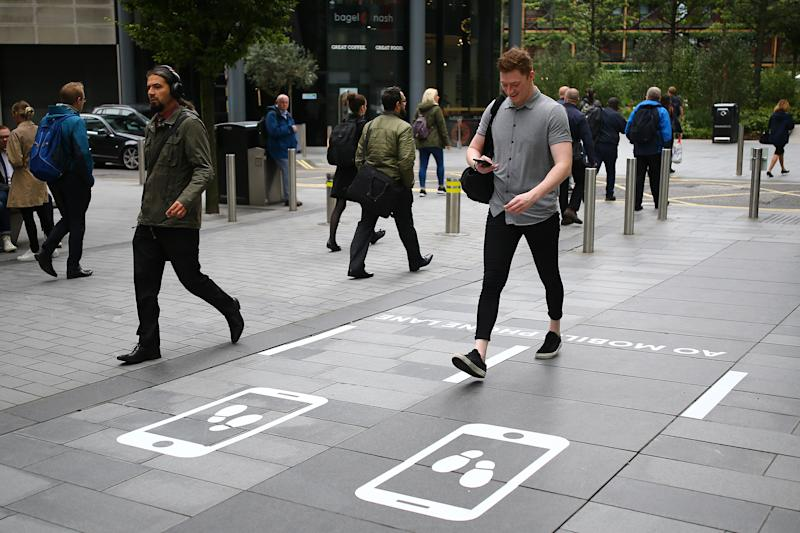 The 250 ft lane comes after research showed 75% of British pedestrians admitted bumping into somebody while on their phone (PA)