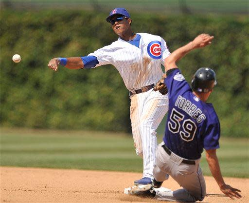 Chicago Cubs shortstop Starlin Castro throws to first base after forcing out Colorado Rockies' Carlos Torres at second base in the seventh inning of a baseball game in Chicago, Saturday, Aug. 25, 2012. DJ LeMahieu was safe at first. Colorado won 4-3. (AP Photo/Paul Beaty)