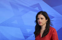 """Israeli Minister of Interior Ayelet Shaked arrives for the first weekly cabinet meeting of the new government in Jerusalem, Sunday, June 20, 2021. Prime Minister Naftali Bennett opened his first Cabinet meeting on Sunday since swearing in his new coalition government with a condemnation of the newly elected Iranian president, whom he called """"the hangman of Tehran."""" (Emmanuel Dunand/Pool Photo via AP)"""