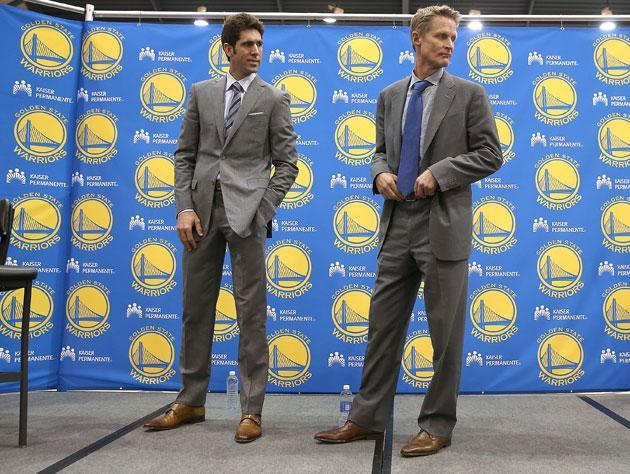 Bob Myers and Steve Kerr sign a five-year deal in 2014. (Getty Images)