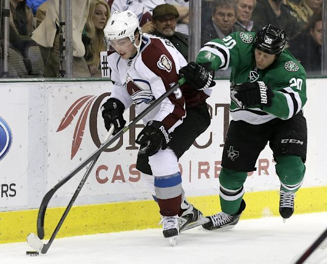 Colorado Avalanche's Matt Duchene (9) is challenged by Dallas Stars' Cody Eakin (20) for control of the puck in the second period of an NHL hockey game, Monday, Jan. 27, 2014, in Dallas. (AP Photo/Tony Gutierrez)