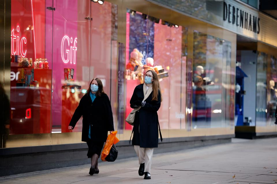Shoppers on a deserted Oxford Street in London. Photo: Tolga Akmen/AFP via Getty Images