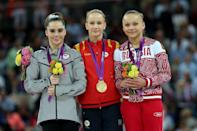 <p>Silver medallist McKayla Maroney Maroney (L) of the United States, gold medallist Sandra Raluca Izbasa of Romania and bronze medallist Maria Paseka of Russia pose with their medals during the medal ceremony following the Artistic Gymnastics Women's Vault final on Day 9 of the London 2012 Olympic Games at North Greenwich Arena on August 5, 2012 in London, England. (Photo by Ronald Martinez/Getty Images) </p>