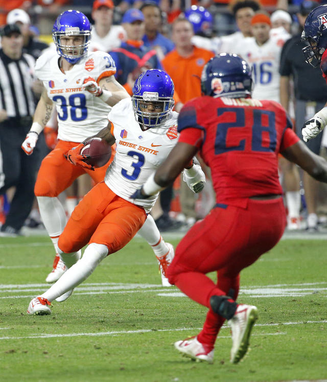 Boise State cornerback Cleshawn Page (3) runs back an interception Arizona running back Nick Wilson (28) defends during the first half of the Fiesta Bowl NCAA college football game, Wednesday, Dec. 31, 2014, in Glendale, Ariz. (AP Photo/Ross D. Franklin)