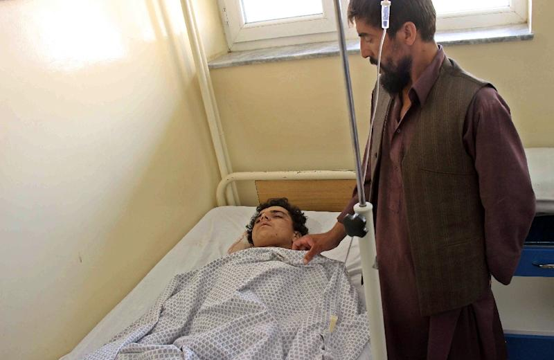 A wounded Afghan receives treatment at a hospital in Kunduz province on August 9, 2015, after a Taliban attack in the northern Afghan city (AFP Photo/Nasir Waqif)