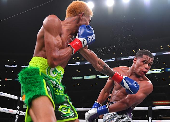 (L-R) Devin Haney and Alfredo Santiago-Alvarez exchange punches during their WBC lightweight championship fight at Staples Center on Nov. 9, 2019 in Los Angeles. Haney won by unanimous decision. (Photo by Jayne Kamin-Oncea/Getty Images)