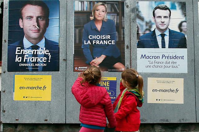 <p>Children walk past election campaign posters for French centrist presidential candidate Emmanuel Macron and far-right candidate Marine Le Pen, in Osses, southwestern France, Friday May 5, 2017. France will vote on Sunday May 7 in the second round of the presidential election. (AP Photo/Bob Edme) </p>