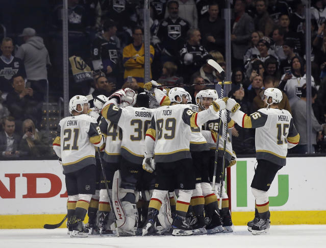 Vegas Golden Knights players celebrate after defeating the Los Angeles Kings 1-0, and sweeping the series in Game 4 of an NHL hockey first-round playoff series in Los Angeles, Tuesday, April 17, 2018. (AP Photo/Alex Gallardo)
