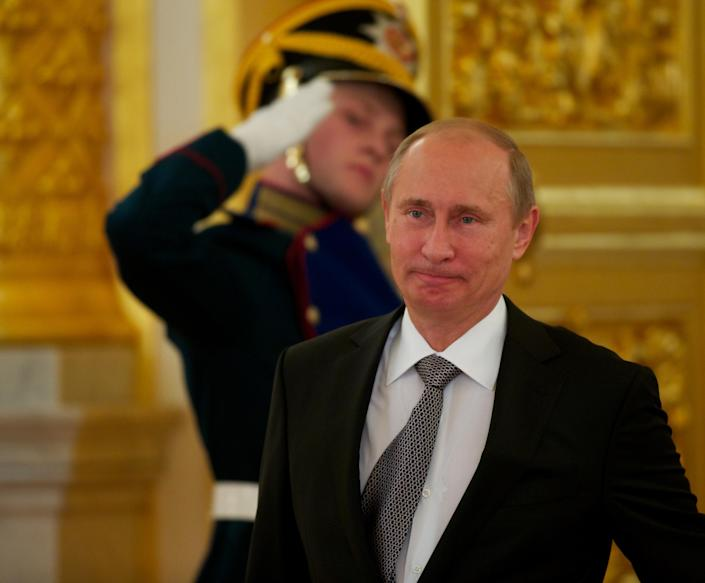 Russian President Vladimir Putin walks prior to a ceremony of receiving credentials in Moscow's Kremlin on Wednesday in Moscow, Russia, Wednesday, Sept. 26, 2012. Russian President Vladimir Putin has renewed calls for a joint international solution to civil conflict in the Middle East in a veiled rejection of Western demands for an end to Syrian leader Bashar Assad's rule. Putin said Wednesday that incitement to the continuation of violence with a view to securing regime change would only create further unrest. (AP Photo/Alexander Zemlianichenko, pool)