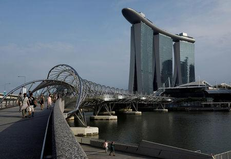FILE PHOTO: People walk past the Marina Bay Sands hotel in Singapore April 10, 2017. REUTERS/Edgar Su/File Photo