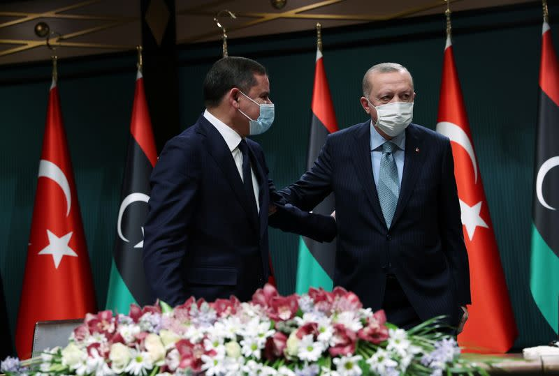 Turkish President Erdogan and Libyan PM Dbeibeh leave after a news conference in Ankara