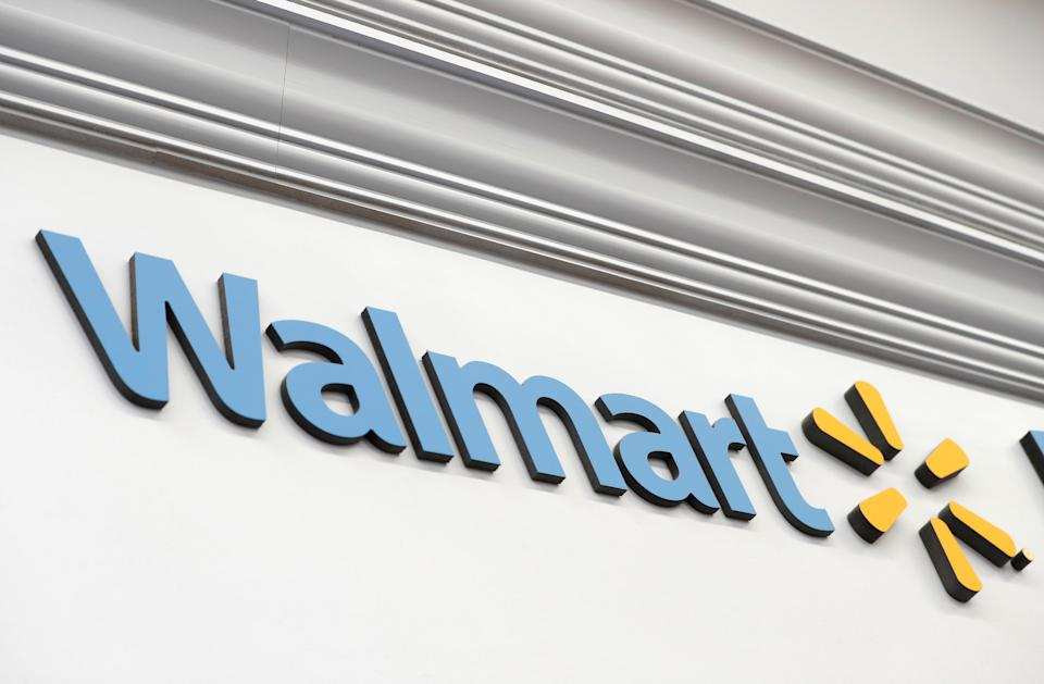 A Walmart sign is seen inside its department store where the Moderna coronavirus disease (COVID-19) vaccine is available as Walmart and other major U.S. pharmacies take part in the Federal Retail Pharmacy Program, to increase vaccinations in the U.S. in West Haven, Connecticut, U.S., February 17, 2021. REUTERS/Mike Segar