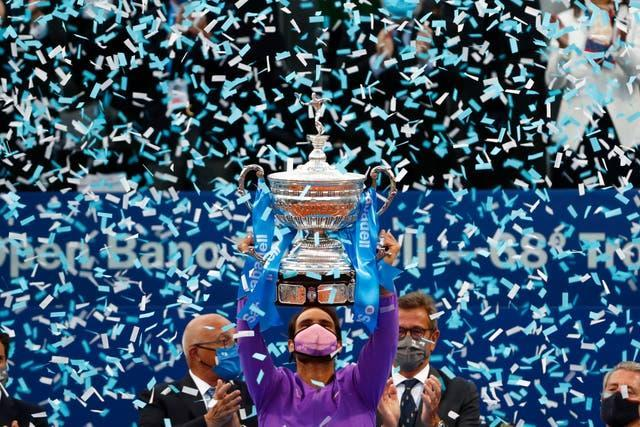 Rafael Nadal holds the Barcelona Open trophy aloft for the 12th time