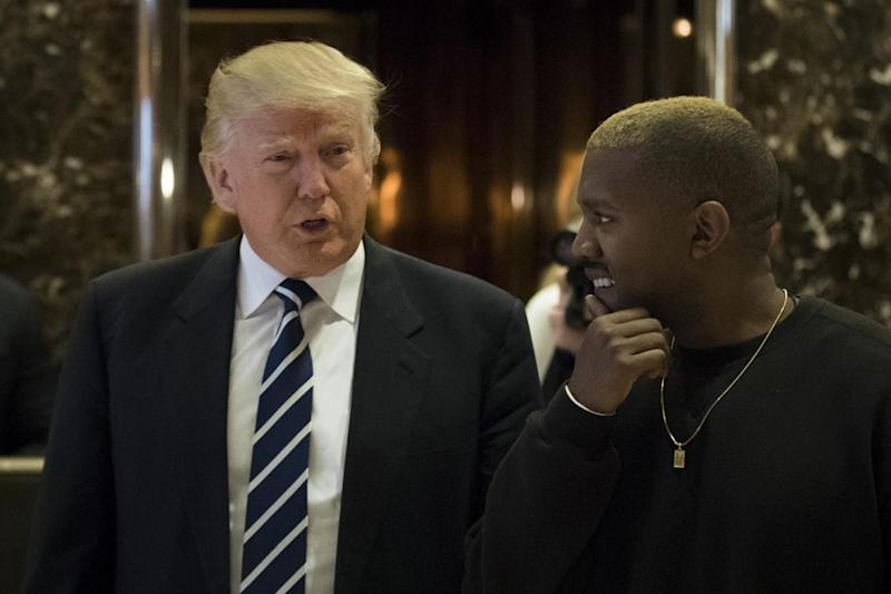 Donald Trump and Kanye West walk into the lobby at Trump Tower in 2016: Getty Images