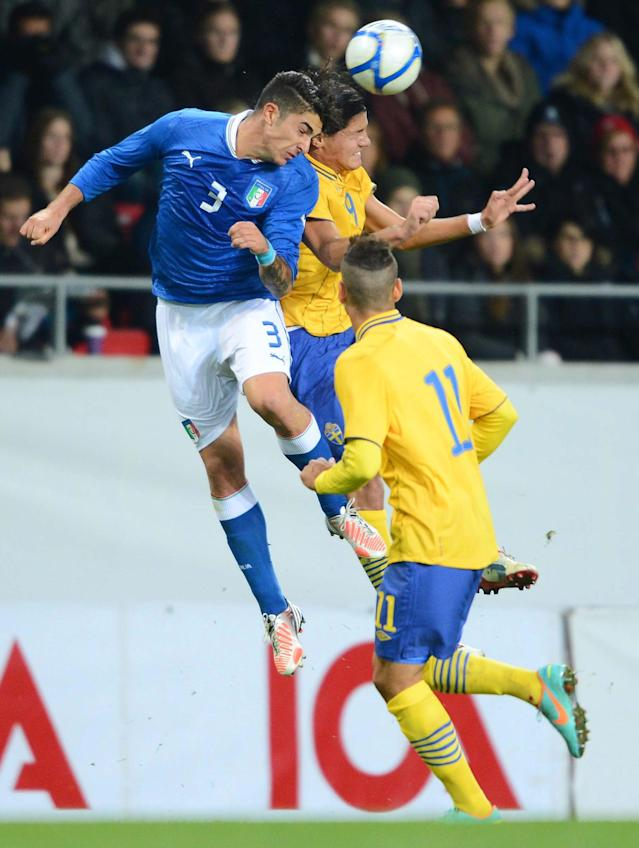Italy's Paolo Frascatore (L) goes for a header with Sweden's Miiko Albornoz (C) during the UEFA European Under-21 Championship qualification match between Sweden and Italy at the Guldfageln arena in Kalmar, on October 16, 2012. AFP PHOTO/SCANPIX/ Patric SoderstromPatric Soderstrom/AFP/Getty Images