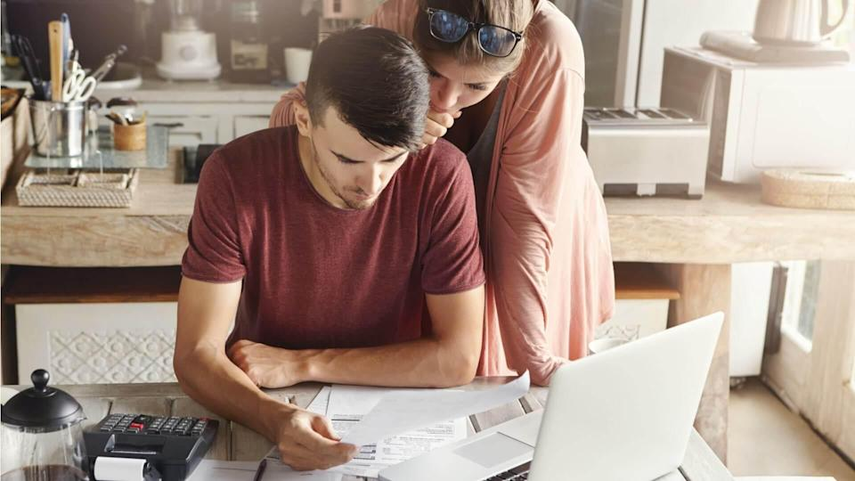 couple doing their finances at home