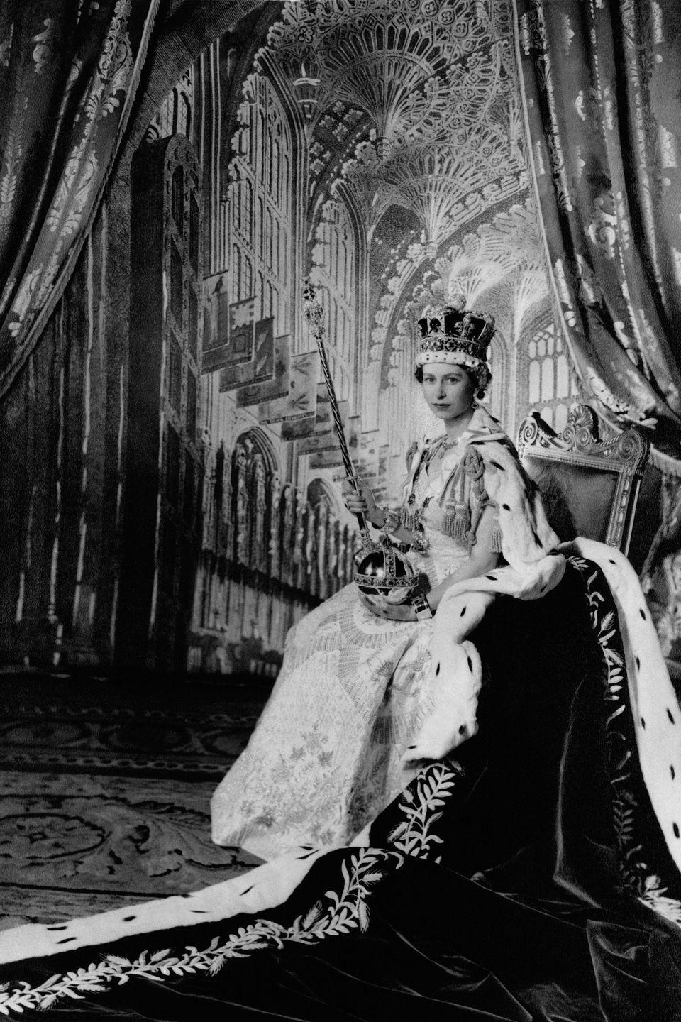 <p>Bow down to the birthday queen. Here, Elizabeth is photographed on her throne after her coronation. </p>