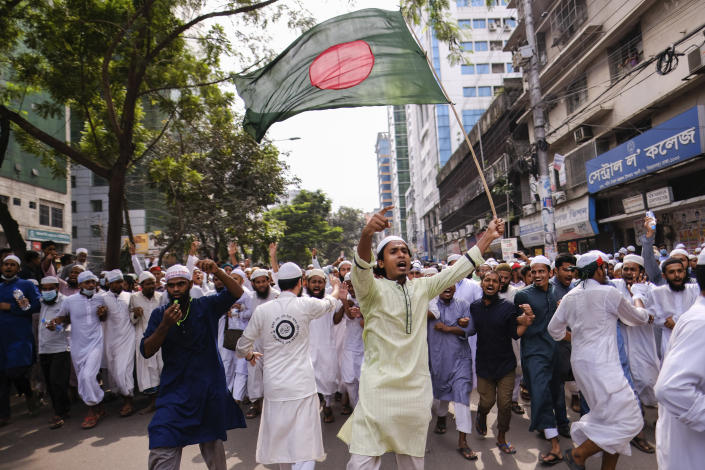 Bangladeshi Muslims protesting the French president's support of secular laws allowing caricatures of the Prophet Muhammad march to lay siege on the French Embassy in Dhaka, Bangladesh, Monday, Nov.2, 2020. (AP Photo/Mahmud Hossain Opu)