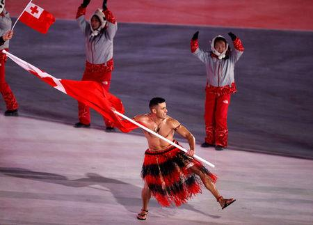 FILE PHOTO - Pyeongchang 2018 Winter Olympics – Opening Ceremony – Pyeongchang Olympic Stadium- Pyeongchang, South Korea – February 9, 2018 - Pita Taufatofua of Tonga carries the national flag during the opening ceremony. REUTERS/Phil Noble