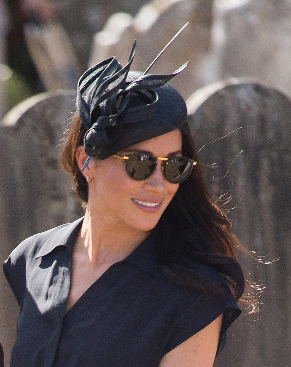 """<p>Meghan defined """"casually elegant"""" with this bespoke black Philip Treacy hat for <a href=""""https://www.popsugar.com/celebrity/photo-gallery/44959497/image/45461259/August-Meghan-steals-show-Charlie-Van-Straubenzee-wedding-same-day-her-37th-birthday"""" class=""""link rapid-noclick-resp"""" rel=""""nofollow noopener"""" target=""""_blank"""" data-ylk=""""slk:the wedding of Prince Harry's dear friend Charlie van Straubenzee"""">the wedding of Prince Harry's dear friend Charlie van Straubenzee</a> in August 2018.</p>"""