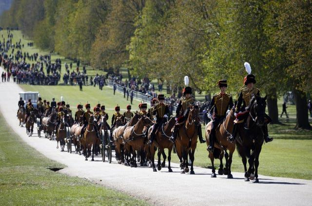 King's Troop Royal Horse Artillery make their way up The Long Walk (Phil Noble/PA)