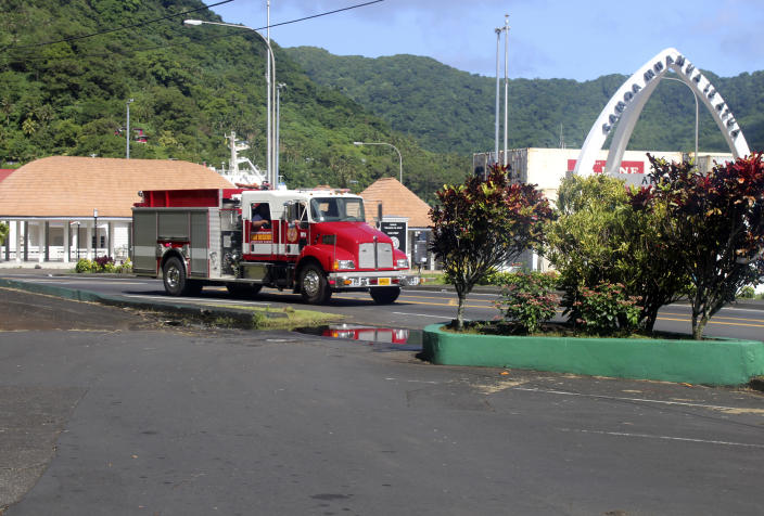 A firetruck tells people along the road, through a public address system (PA) to move to higher grounds following a tsunami warning for American Samoa in Pago Pago, Thursday, March 4, 2021. The Pacific Tsunami Warning Center cancelled a tsunami watch for Hawaii that was issued after a huge earthquake occurred in a remote area between New Zealand and Tonga. The agency previously cancelled a tsunami warning it had issued for American Samoa. (AP Photo/Fili Sagapolutele)