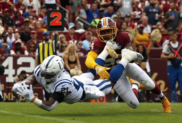 <p>Indianapolis Colts running back Nyheim Hines, left, scores a touchdown in front of Washington Redskins defensive back Josh Norman in the first half of an NFL football game, Sunday, Sept. 16, 2018, in Landover, Md. (AP Photo/Alex Brandon) </p>