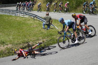 Spain's Peio Bilbao crashes in a corner during the fourteenth stage of the Tour de France cycling race over 183.7 kilometers (114.1 miles) with start in Carcassonne and finish in Quillan, France, Saturday, July 10, 2021. (AP Photo/Christophe Ena)