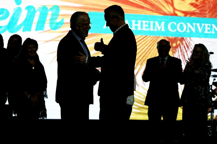 Incoming Southern Baptist Convention President Ed Litton, center left, talks with outgoing President J. D. Greear, center right, at the conclusion of the annual Southern Baptist Convention meeting, Wednesday, June 16, 2021, in Nashville, Tenn. (AP Photo/Mark Humphrey)