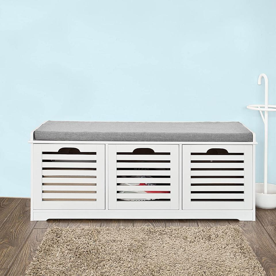 """<h2><a href=""""https://www.amazon.com/dp/B01I36KA0W/"""" rel=""""nofollow noopener"""" target=""""_blank"""" data-ylk=""""slk:Haotian 3-Cube White Storage Bench"""" class=""""link rapid-noclick-resp"""">Haotian 3-Cube White Storage Bench</a></h2><br>This dual-use furniture item offers a cushioned seat (perfect for when you've got a shoe to tie or a call to take) along with storage space for everything from boots to blankets to umbrellas. <br><br><strong>Haotian</strong> Haotian 3-Cube White Storage Bench, $, available at <a href=""""https://www.amazon.com/dp/B01I36KA0W/"""" rel=""""nofollow noopener"""" target=""""_blank"""" data-ylk=""""slk:Amazon"""" class=""""link rapid-noclick-resp"""">Amazon</a>"""