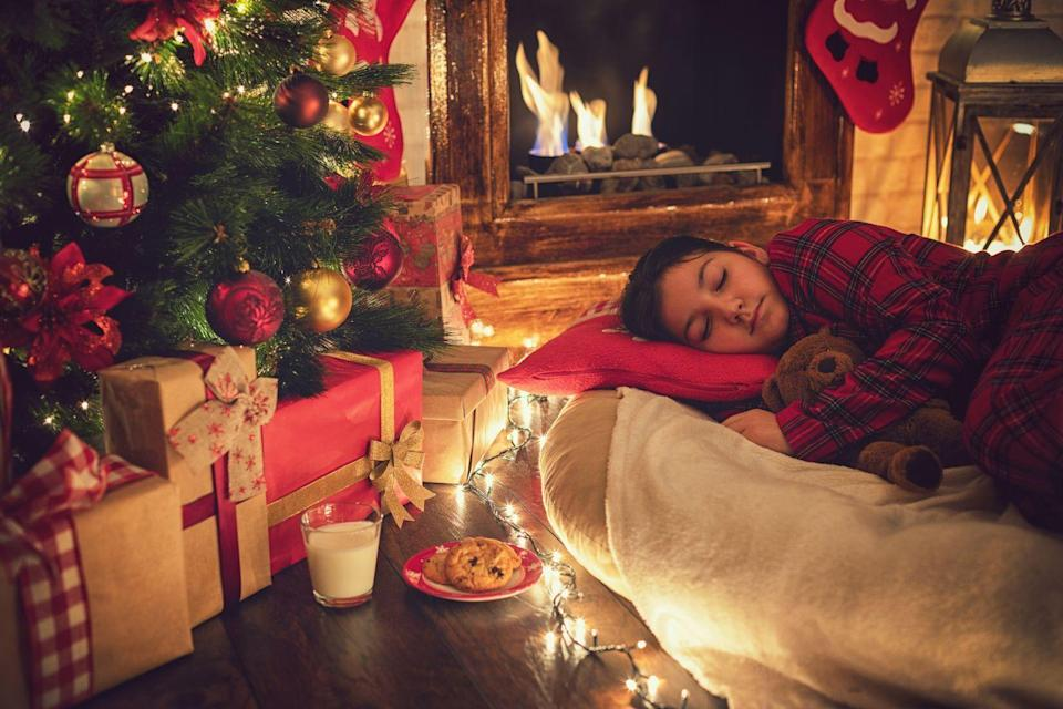 <p>If there's one night of the year to let the kids (and yourself) out of bed, this is it. Put on your comfiest pajamas, snuggle up under the tree, and await the new day (and the new year). </p>