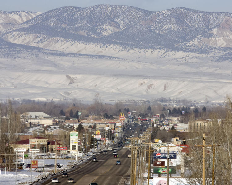 FILE - In this Feb. 10, 2011 file photo, downtown Vernal, Utah is shown. State health officials are pledging to look into claims that stillbirths are on the rise in the Eastern Utah community of Vernal, that is home to a boom in gas and oil development. Activists say a climbing rate of neonatal deaths in the Uinta Basin stems from industrial smog. But researchers and health officials aren't ready to draw such a link. (AP Photo/The Salt Lake Tribune, Steve Griffin, File)