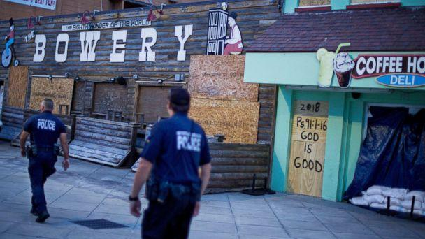 PHOTO: Police patrol past boarded up shops along the boardwalk in Myrtle Beach, S.C., Thursday, Sept. 13, 2018, as Hurricane Florence approaches the east coast. (David Goldman/AP)