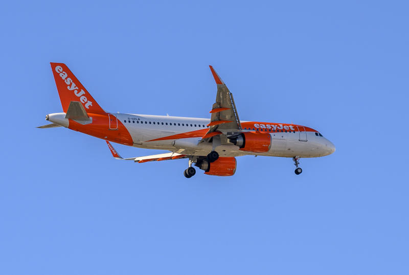 LISBON, PORTUGAL - JANUARY 03: EasyJet G-UZLB Airbus A320 flies over the city while approaching Humberto Delgado International Airport on January 11, 2020 in Lisbon, Portugal. The number of foreign tourists visiting Portugal attained another record in 2019. (Photo by Horacio Villalobos#Corbis/Corbis via Getty Images)