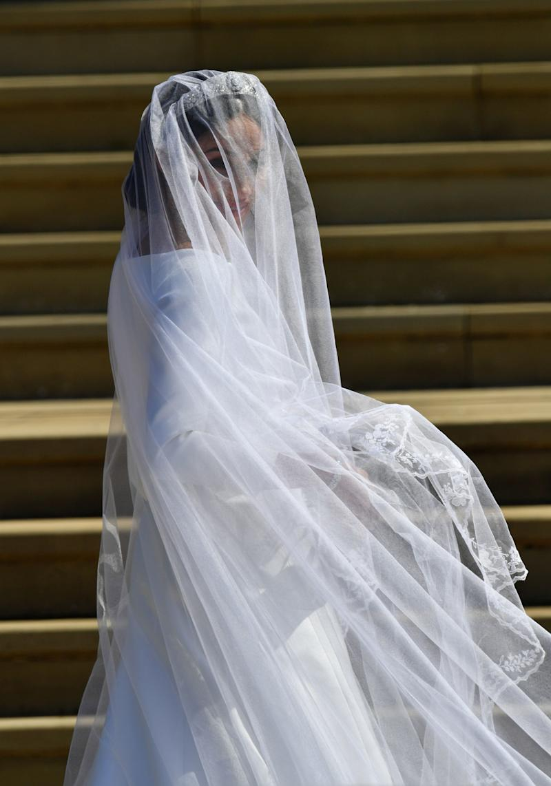 US actress Meghan Markle arrives for the wedding ceremony to marry Britain's Prince Harry, Duke of Sussex, at St George's Chapel, Windsor Castle, in Windsor, on May 19, 2018. (Photo by Ben Birchall / POOL / AFP) (Photo credit should read BEN BIRCHALL/AFP/Getty Images)