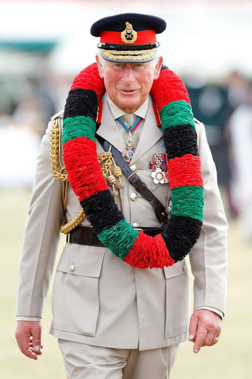 <p>Prince Charles wears a traditional Nepalese Mala garland as he visits the Sir John Moore Barracks in Folkestone, England. </p>
