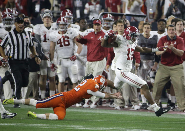 Alabama's Kenyan Drake gets past Clemson kicker Greg Huegel as he runs back a kick off for a touchdown during the second half of the NCAA college football playoff championship game Monday, Jan. 11, 2016, in Glendale, Ariz. (AP Photo/David J. Phillip)
