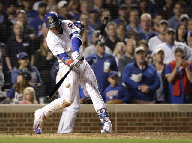 Chicago Cubs' Albert Almora Jr., hits a game winning RBI single off Los Angeles Dodgers relief pitcher Brock Stewart during the 10th inning of a baseball game Tuesday, June 19, 2018, in Chicago. Kris Bryant scored in the 2-1 win. (AP Photo/Charles Rex Arbogast)