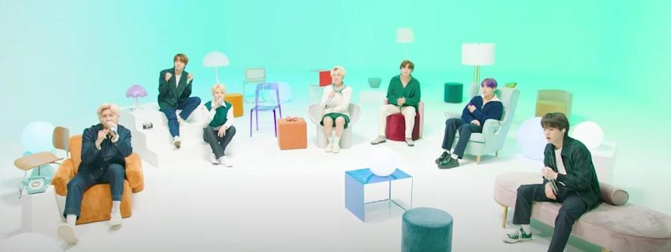 """BTS sit on colourful furniture performing """"Look Here"""""""