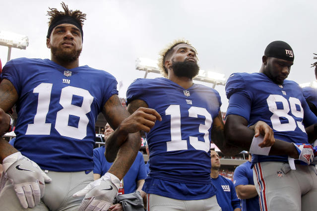 <p>Wide Receivers Roger Lewis, Jr. #18, Odell Beckham, Jr. #13 and Tight End Jerell Adams #89 of the New York Giants lock arms during the National Anthem befoe the game against the Tampa Bay Buccaneers at Raymond James Stadium on October 1, 2017 in Tampa, Florida. (Photo by Don Juan Moore/Getty Images) </p>