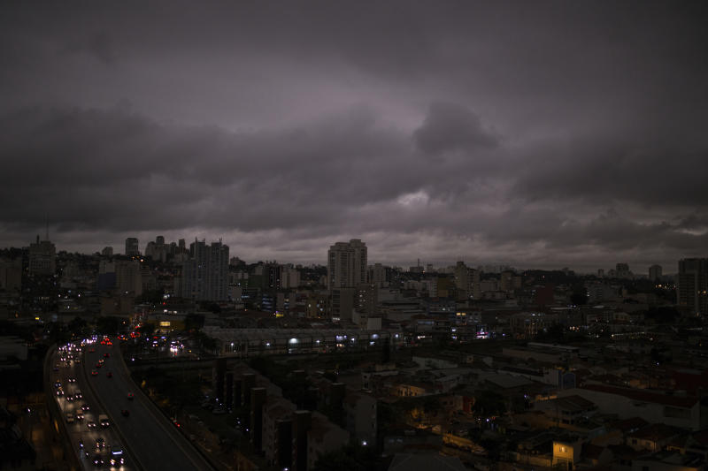 Darkened skies in Sao Paulo, seen on Monday, August 19. Residents of this metropolis of millions recently reported black rain. Studies by two universities confirmed that the rainwater contains fire residues. | Andre Lucas—AP Images