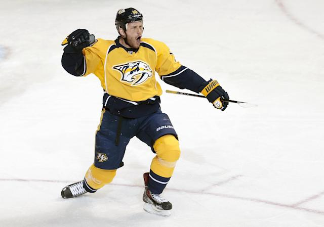 Nashville Predators forward Rich Clune celebrates after scoring a goal against the Anaheim Ducks in the second period of an NHL hockey game Thursday, Jan. 9, 2014, in Nashville, Tenn. (AP Photo/Mark Humphrey)