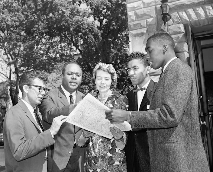 Members of the Congress of Racial Equality gather in Washington with a map of a route they plan to take to test segregation in bus terminal restaurants and rest rooms in the South on May 4, 1961. From left are Edward Blankenheim, Tucson, Arizona; James Farmer, New York City; Genevieve Hughes, Chevy Chase, Maryland; the Rev. B. Elton Cox, High Point, North Carolina, and Henry Thomas, St. Augustine, Florida.