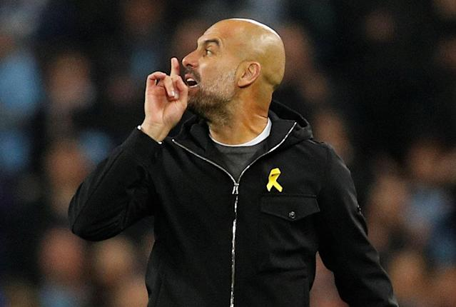 Pep Guardiola gestures toward the referee after being sent off at halftime of Manchester City's Champions League quarterfinal second leg against Liverpool. (Reuters)