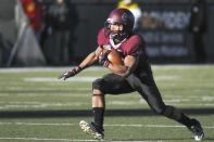 Montana running back Jordan Canada (26) cuts upfield during the first half of an NCAA college football playoff game against San Diego, Saturday, Nov. 29, 2014, in Missoula, Mont. (AP Photo/Lido Vizzutti)
