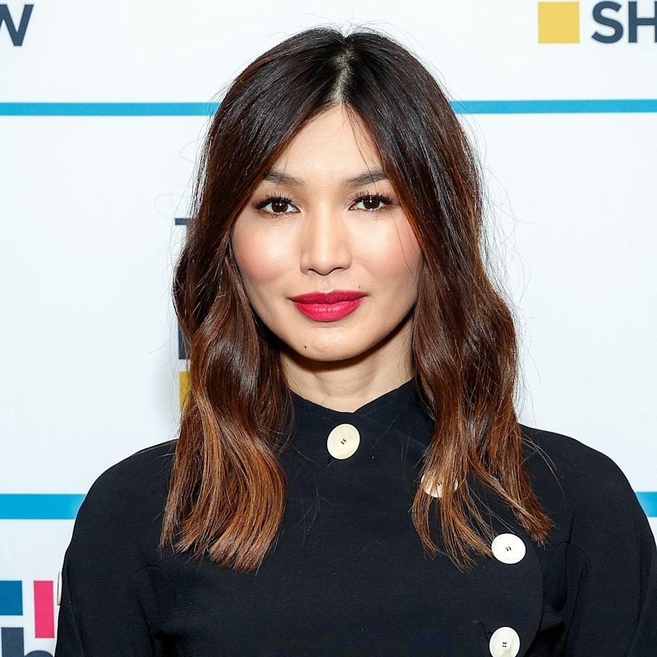 """<p>The addition of the caramel hues gives <a href=""""https://www.allure.com/story/gemma-chan-cover-story-2019?mbid=synd_yahoo_rss"""" rel=""""nofollow noopener"""" target=""""_blank"""" data-ylk=""""slk:Gemma Chan"""" class=""""link rapid-noclick-resp"""">Gemma Chan</a>'s hair that sun-kissed feel and also complements her naturally-dark roots. """"Warmer tones help reflect light and add the perfect glow to her fair skin,"""" says <a href=""""https://www.instagram.com/morganparks_/"""" rel=""""nofollow noopener"""" target=""""_blank"""" data-ylk=""""slk:Morgan Parks"""" class=""""link rapid-noclick-resp"""">Morgan Parks</a>, a colorist at <a href=""""https://www.instagram.com/ninezeroone/?hl=en"""" rel=""""nofollow noopener"""" target=""""_blank"""" data-ylk=""""slk:Nine Zero One Salon"""" class=""""link rapid-noclick-resp"""">Nine Zero One Salon</a> in Los Angeles. """"Maintaining rich highlights can be tricky, so using a color-safe <a href=""""https://shop-links.co/1683632160872939637"""" rel=""""nofollow noopener"""" target=""""_blank"""" data-ylk=""""slk:shampoo"""" class=""""link rapid-noclick-resp"""">shampoo</a> and <a href=""""https://shop-links.co/1683632176583525388"""" rel=""""nofollow noopener"""" target=""""_blank"""" data-ylk=""""slk:conditioner"""" class=""""link rapid-noclick-resp"""">conditioner</a> like [the ones from] Oribe's Beautiful Color line help the longevity of your color and enhances the shine."""" </p> <p>For this hue, she also suggests the <a href=""""https://shop-links.co/1683632285624422982"""" rel=""""nofollow noopener"""" target=""""_blank"""" data-ylk=""""slk:Evo Fabuloso Color Boosting Treatment"""" class=""""link rapid-noclick-resp"""">Evo Fabuloso Color Boosting Treatment</a> in the caramel shade. """"It can help maintain that salon hair color between visits.""""</p>"""