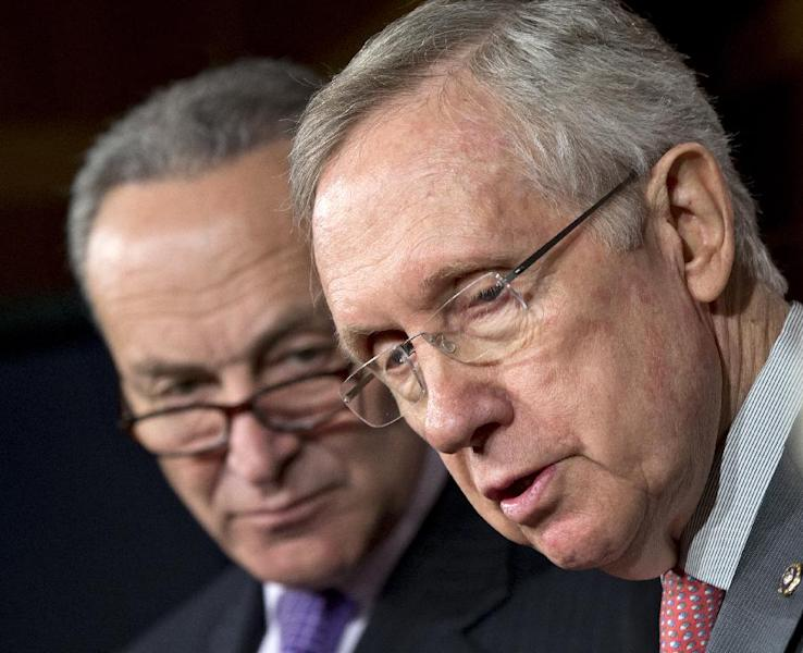 Senate Majority Leader Harry Reid of Nev., right, accompanied by Sen. Charles Schumer, D-N.Y., faces reporters on Capitol Hill in Washington, Thursday, Feb. 28, 2013, to talk about the impending automatic spending cuts that take effect March 1. (AP Photo/J. Scott Applewhite)