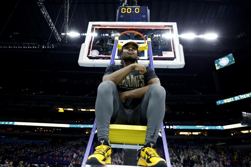Davion Mitchell #45 of the Baylor Bears sits on a ladder with the trophy after defeating the Gonzaga Bulldogs in the National Championship game of the 2021 NCAA Men's Basketball Tournament at Lucas Oil Stadium on April 05, 2021 in Indianapolis, Indiana. The Baylor Bears defeated the Gonzaga Bulldogs 86-70. (Photo by Tim Nwachukwu/Getty Images)