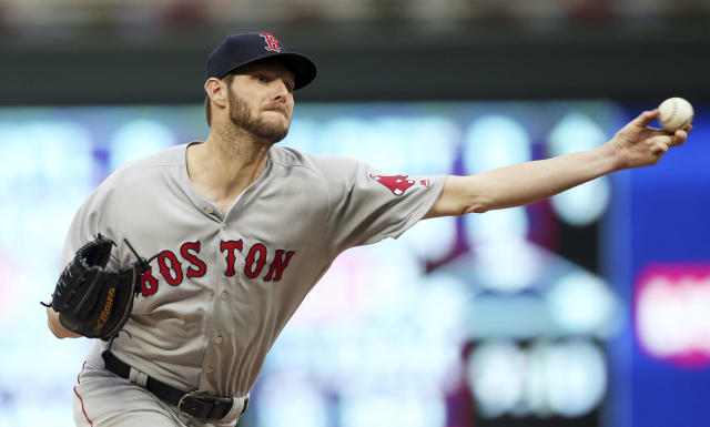 Boston Red Sox pitcher Chris Sale throws to a Minnesota Twins batter during the third inning of a baseball game Tuesday, June 19, 2018, in Minneapolis. (AP Photo/Jim Mone)
