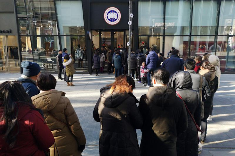 People queue outside the newly opened flagship store of Canadian luxury parka maker Canada Goose, in Sanlitun district of Beijing, China December 30, 2018. REUTERS/Stringer ATTENTION EDITORS - THIS IMAGE WAS PROVIDED BY A THIRD PARTY. CHINA OUT.